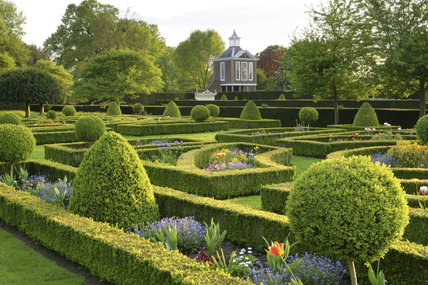 The Tall Pavilion built in 1702-3 at Westbury Court Garden, Gloucestershire, UK with the Parterre and topiary in the foreground