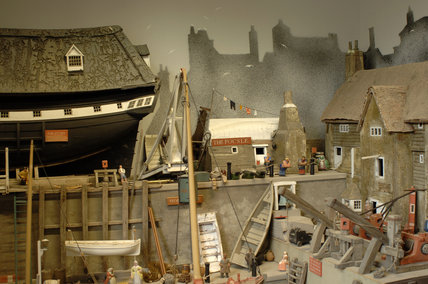 Close view of the Harbour Master's House, The Focsle and the warehouse, part of the reconstruction of Wolf's Cove, the model village which was once in the garden at Snowshill Manor but is now in the room known as Occidens