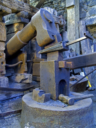 The water powered tilt hammer in action at Finch Foundry in Devon where agricultural and mining hand tools were produced in the C19th  (Digital images only, no transparencies)