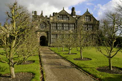 Exterior view of the garden front of East Riddlesden Hall at Keighley, West Yorkshire, a seventeenth-century manor house with mullioned windows