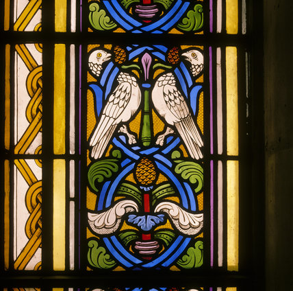 Detail of border in stained glass window by Thomas Willement, dating from 1835, depicting doves, at Penrhyn Castle