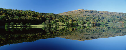 View of Grasmere in flat calm with perfect reflection, Cumbria