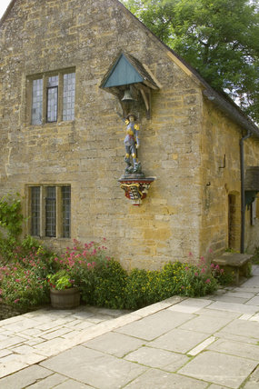The teak statue of St George mounted on the wall of Charles Paget Wade's cottage at Snowshill Manor, Gloucestershire, UK