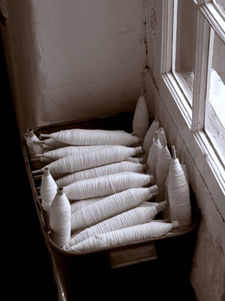 Cotton reels in a basket in the Weaving Shed at Quarry Bank Mill, Styal