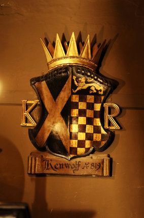 The coat of arms of Kenulf 13th, King of Mercia, on the wall of Dragon at Snowshill Manor