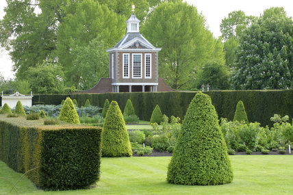 The Tall Pavilion built in 1702-3 at Westbury Court Garden, Gloucestershire, UK with the box hedging and topiary of the Parterre in the foreground