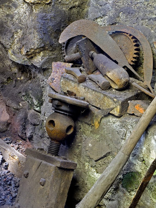 Tools and steel miscellania piled up at Finch Foundry where hand tools were produced in the C19th and C20th