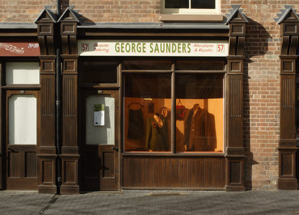 The shopfront of George Saunders, the tailors, on Hurst Street, part of Court 15, Birmingham Back to Backs