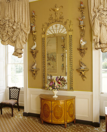 The Hunting Room: English pier-glass dated about 1770, semi- circular satinwood commode about 1775, oriental birds on rococo gilt wall-brackets 1750-60, on either side