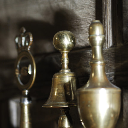 A collection of ornamental tops of guild staves in the Lobby at Snowshill Manor, home of collector Charles Wade