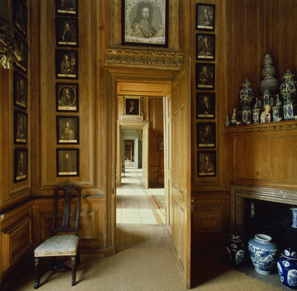 A view through the State Dressing Room at Beningbrough Hall showing an enfilade of doors through to other rooms
