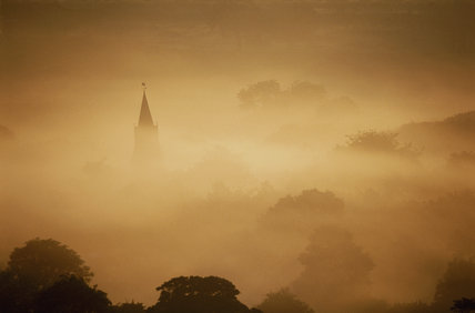 The spire of Edale church rising up through the dawn mist