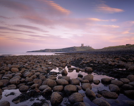 View of Dunstanburgh Castle from the north west at low tide