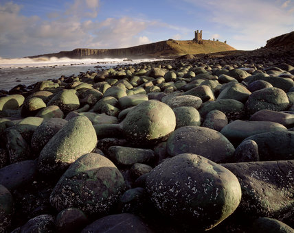 View of Dunstanburgh Castle from the north west taken on a stormy winter afternoon
