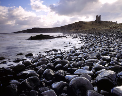 View of Dunstanburgh Castle from the north west in stormy weather