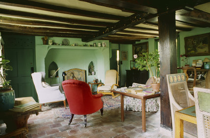 A view of the Sitting Room at Monk's House, painted in the green paint that was so favoured by Virginia Woolf