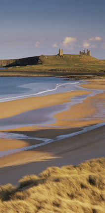 View of Dunstanburgh Castle from the high dunes at Embleton Beach taken mid-afternoon