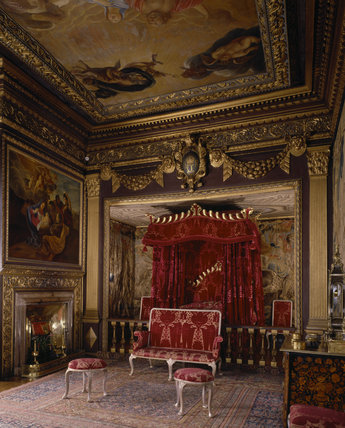 View of the State Bedroom at Powis Castle showing the state bed, cipher, balustrade rail, ceiling and silvered gesso set of furniture c. 1725