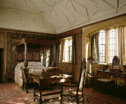 View of Great Chamber with large oak bed with panelled tester, one of the earliest examples of an enriched plaster ceiling, coved and ribbed, c 1533