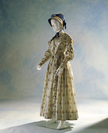 View of a printed wool/silk day dress with a blue bonnet c.1837-40