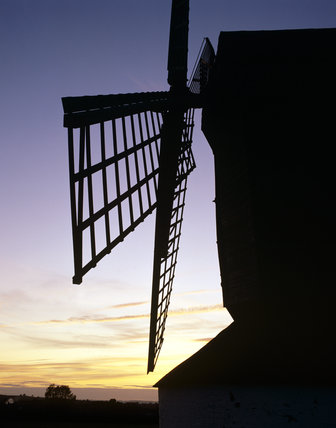 View showing sails of Pitstone Windmill set against sunset