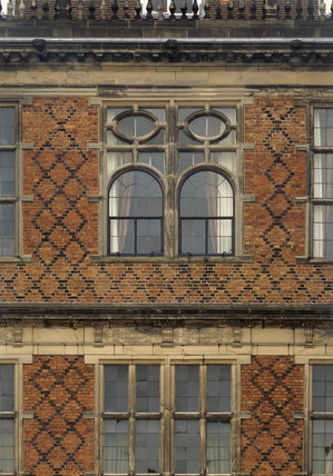Detail of windows in the north front showing the oval shape, and also the blue diaper brick work