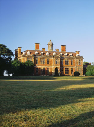 The south front of the Hall, taken from the lawn, illuminated by the late evening sun