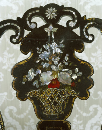 Detail of an inlaid chair back in lacquer & mother of pearl in a basket of flowers motif from the Victorian Bedroom at Melford Hall