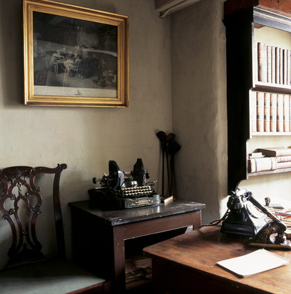 Part of the W.M.Heelis Offices, now the Beatrix Potter Gallery at Sawrey, showing an old telephone and typewriter & golf clubs leaning against the wall in the corner.