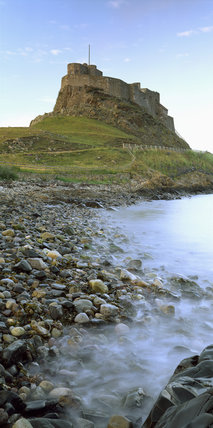 Lindisfarne Castle perched on a rocky crag and accessible only by a causeway at low tide