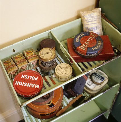 Household items including shoe polish and wallpaper paste in a green metal container at 59 Rodney Street, Liverpool, the E.Chambre Hardman Studio, House and Photographic Collection.