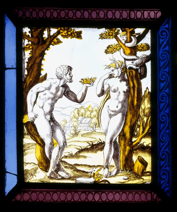 Detail of an early stained glass window in the Hall at Melford Hall, depicting Adam tempting Eve