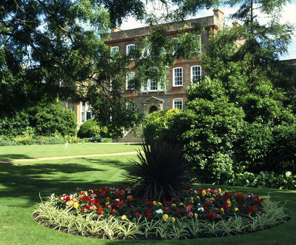 An island flower-bed planted in typical Victorian style with brightly coloured begonias on the Palm Lawn at Peckover House