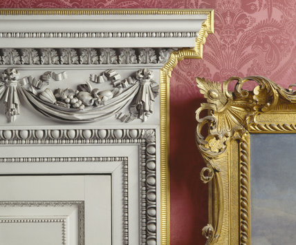 A detailed close up of the carved doorcase, supplied by Paine in 1751, for the Drawing Room, where William II hung his larger Grand Tour pictures