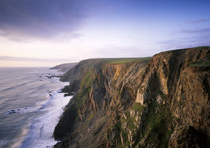 The cliffs above Sandy Mouth on the Cornish Coast looking north at dusk