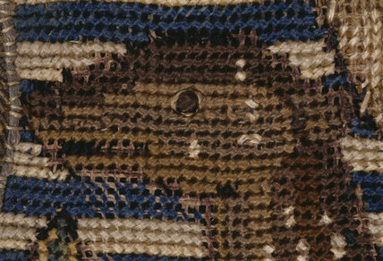 Detail of an animal's head from the Marian Tapestry at Oxburgh Hall