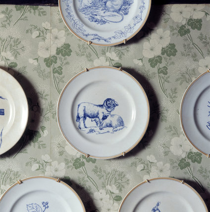 Close shot of one of the 8 plates painted with animals and birds by her father, Rupert, at Hill Top, the home of Beatrix Potter in Sawrey, Cumbria