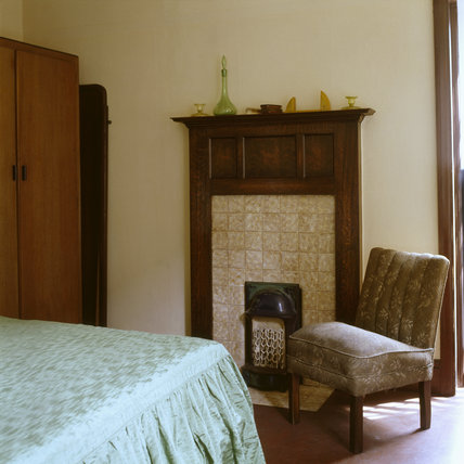 The Bedroom at 59 Rodney Street, Liverpool, the E. Chambre Hardman Studio, House and Photographic Collection - showing a corner of the bed with coverlet, and the fireplace.