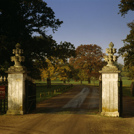 The main entrance Gate Piers surmounted by large carved urns, and Ickworth Park Drive leading up to the house