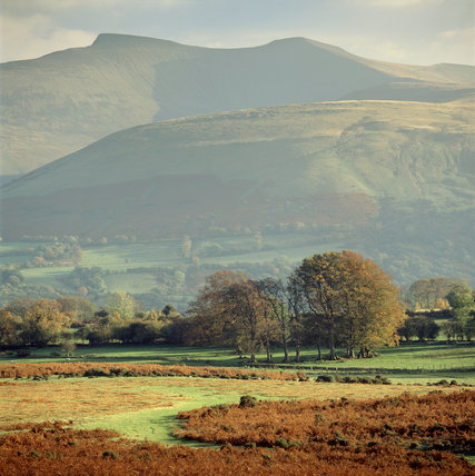 Long views of the highest of the Brecon Beacons, showing Pen Y Fan and Corn Du from the north west