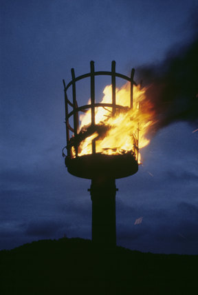 Lighting of the Armada Beacon by NT Warden, George Elliot, in August 1987, at the Golden Cap Estate