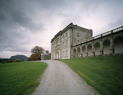 The East front of Florence court, including the colonnade and driveway, on a dark and foreboding autumnal day
