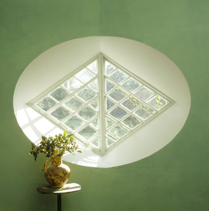 Light coming through a diamond shaped window at A la Ronde, in oval surround with mint green walls