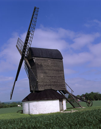 A side view of the Mill silhouetted against the cloudy blue sky