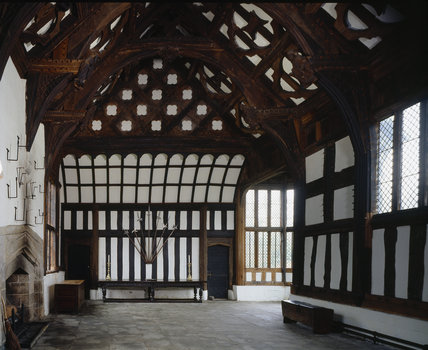 View of the Great Hall at Rufford Old Hall showing high table, coved canopy and hammer-beam roof