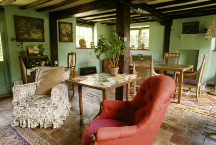 Monk's House, the sitting room with walls of green paint favoured by Virginia Woolf