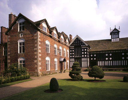 View of the north (black and white frontage) wing and the west front at Rufford Old Hall