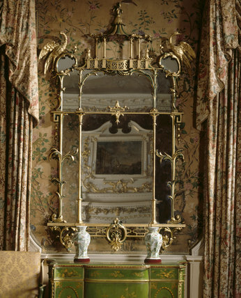 View of the Chippendale commode and pier glass mirror in the State Bedchamber at Nostell Priory
