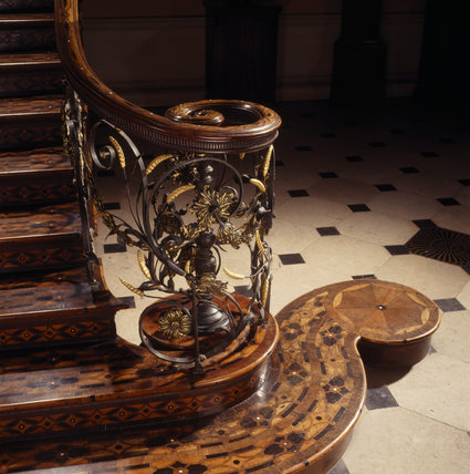 Partial view of the foot of the staircase in the staircase hall