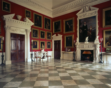 Room view of the Entrance Hall at Stourhead showing the doors into the Inner Hall and chimneypiece with a portrait of 'Sir Richard Coalt Hoare with his son Henry, 1795 by Samuel Woodforde